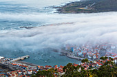 Fog and town of A Guarda viewed from Santa Tegra Mountain, Galicia, Spain