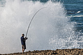Fishing in extreme conditions in the Atlantic near Sintra.