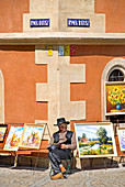 Wroclaw, Silesia, Poland. Artist selling paintings in front of the Town Hall, Rynek Ratusz