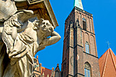 Wroclaw, Silesia, Poland. Church of the Holy Cross and St Bartholemew; angel at base of the statue of St John Nepomuk
