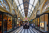 MELBOURNE - APR 13 2014:People shopping at Royal Arcade in Melbourne, Australia.It's a significant Victorian era arcade shopping passage and one of the most famous tourist destinations in Melbourne.
