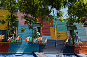 Colorful houses with large statues in La Boca, a Buenos Aires neighborhood which is a major tourist attraction in Buenos Aires, Argentina.