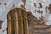 The door of the bell tower of San Lucas in the oasis town of Toconao near San Pedro de Atacama in the Atacama Desert, northern Chile is made from the wood of the cardon cactus.