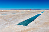 Salt mining at Salinas Grandes a salt pan in the Andes Mountains - is situated on an altitude of 3.450 meters on the border of the provinces of Salta and Jujuy, Argentina.