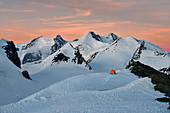 Camping with tent surrounded by Monte Rosa glaciers, Gobba di Rollin, Monte Rosa, Aosta Valley, Italy