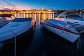 Town of Krk, waterfront view at evening with some boats moored, island of Krk, Kvarner bay, Adriatic coast, Croatia