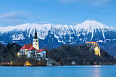 Lake Bled at evening with the snowy Karawanks mountains on the background,Bled, Upper Carniola region, Slovenia, Europe