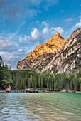 Braies / Prags, Dolomites, South Tyrol, Italy. The Lake Braies / Pragser Wildsee and the peak of Herrstein at sunset