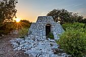 Marina di Pescoluse, Salve, province of Lecce, Salento, Apulia, Italy, Europe. A trullo is a traditional Apulian dry stone hut