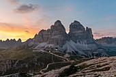 Mount Campedelle, Misurina, Auronzo di Cadore, province of Belluno, Veneto, Italy, Europe. The Tre Cime di Lavaredo at sunset