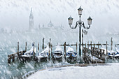 Snowy Venice, a rare snowfall in Riva degli Schiavoni with St. George's island in the background, Venice, Veneto, Italy
