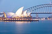 Sydney Harbour Bridge and Opera House at dusk, Sydney, New South Wales, Australia