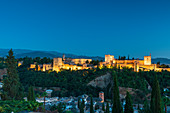 Illuminated Alhambra palace and fortress complex at dusk, Granada, Andalusia, Spain