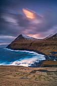 Cloudy sky at sunset over the coastal village of Gjogv, Eysturoy island, Faroe Islands, Denmark
