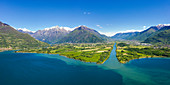 Aerial panoramic of river Adda flowing into the blue Lake Como, Trivio di Fuentes, Lower Valtellina, Lombardy, Italy