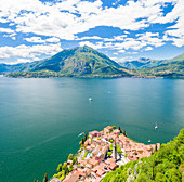 Aerial panoramic of Varenna and Lake Como with Menaggio and Monte Crocione on opposite coastline, Lecco province, Lombardy, Italy