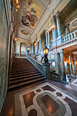 Ancient columns and frescoes on ceiling in the interior hall of the Royal Palace, Stockholm, Sweden