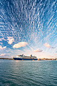 Sunset over luxury cruise ship ready to sail from harbor in the Caribbean Sea, Antilles, Central America