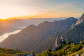 Aerial view of sunset over Lake Como and Grignetta (Grigna Meridionale) from Rifugio Rosalba, Lecco province, Lombardy, Italy