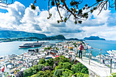 Man admiring Alesund and ocean from platform at Byrampen viewpoint, Aksla, More og Romsdal county, Norway