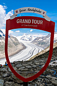 Aletsch Glacier framed by signpost at the Eggishorn viewpoint, Bernese Alps, canton of Valais, Switzerland