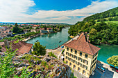 Elevated view of Aarburg old town and Aare river surrounded by green hills, Canton Aargau, Switzerland