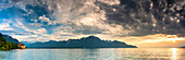 Panoramic of clouds at sunset on Lake Geneva and Chillon Castle (Chateau de Chillon), Veytaux, Montreux, Canton‎ Vaud, Switzerland