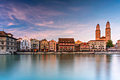 Sunset over the old buildings of Limmatquai and Grossmunster Cathedral, Zurich, Switzerland