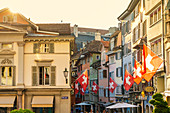 Swiss flags hanging from buildings of Lindenhof, Old Town of Zurich, Switzerland