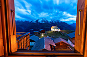 Dusk over Bettmeralp seen from the open window of chalet, canton of Valais, Switzerland