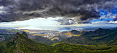 Storm clouds over Le Pouce mountain and Port Louis in background, aerial view, Moka Range, Mauritius