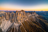 Warm light of sunset on Torri Del Vajolet and Catinaccio in autumn, Catinaccio Group, aerial view, Dolomites, South Tyrol, Italy
