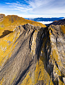 Aerial panoramic of rock face of the high mountains in autumn, First, Grindelwald, Canton of Bern, Switzerland