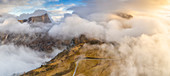 Sunset over Giau Pass in a sea of clouds during autumn, aerial view, Dolomites, Belluno province, Veneto, Italy
