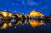 Dusk over Castel Sant'Angelo and bridge along river Tiber, Rome, Lazio, Italy