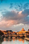 River Tiber and St. Peter's Basilica (Basilica di San Pietro) at sunrise, Rome, Lazio, Italy