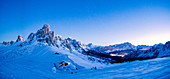 Panoramic of Ra Gusela, Monte Cristallo and Cortina d'Ampezzo covered with snow at dusk, Giau Pass, Dolomites, Veneto, Italy