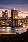 A view of Brooklyn district of New York city and Brooklyn bridge  from Manhattan Bridge. Manhattan, New York City, New York, USA.