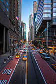 High skyscrapers and a perfectly straight road in Manhattan, New York City, USA