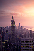 New York city Skyline with Empire State Building and Liberty Tower during sunset, from Top Of The Rock Building.