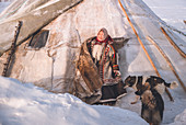 A young nenets girl. The traditional way of daily life at the nomadic reindeer herders camp. Polar Urals, Yamalo-Nenets autonomous okrug, Siberia, Russia