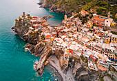 Aerial view of Vernazza, a small and colorful village into the Cinque Terre Natural Park. La Spezia province, Liguria, Italy