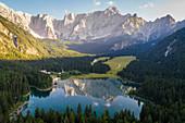 Aerial view of superior Fusine Lake with Mount Mangart on the background. Fusine Lakes Natural Park, Tarvisio, Udine province, Friuli Venezia Giulia, Italy.