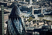 Aerial view of The Gherkin office building and Tower Bridge over the river Thames in London.