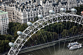 Aerial view of the London Eye and passenger pods above the river Thames.