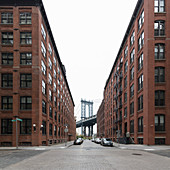 View along empty street towards Manhattan Bridge, New York City, USA during the Corona virus crisis.