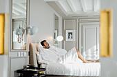 Man relaxing in suite