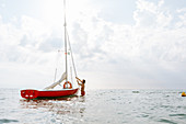 Man preparing sailboat