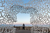 """France, Alpes-Maritimes, Antibes, terrace of the bastion Saint-Jaume in the port Vauban, the transparent sculpture the """"Nomad"""", created by the Spanish sculptor Jaume Plensa, the bust formed by letters"""
