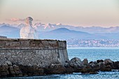 "France, Alpes-Maritimes, Antibes, terrace of the bastion Saint-Jaume in the port Vauban, the transparent sculpture the ""Nomad"", created by the Spanish sculptor Jaume Plensa, the bust formed by letters, in background the Alps of the South covered with snow"